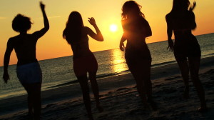stock-footage-group-carefree-boy-girl-teenagers-casual-beachwear-enjoying-beach-party-at-sunset-on-vacation